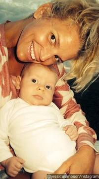 Jessica Simpson Cuddles Friend's Baby in New Photo, Says 'I Do Not Want Another'